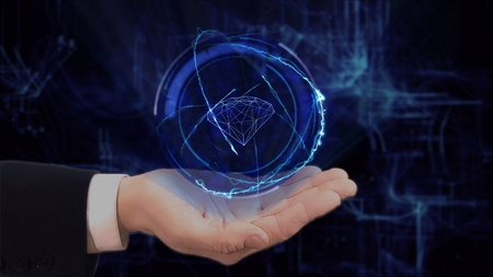 Painted hand shows concept hologram 3d diamond on his hand. Drawn man in business suit with future technology screen and modern cosmic background