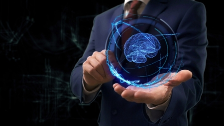 Businessman shows concept hologram 3d brain on his hand. Man in business suit with future technology screen and modern cosmic background