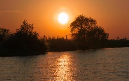 orange sunset: Orange sunset over the river.
