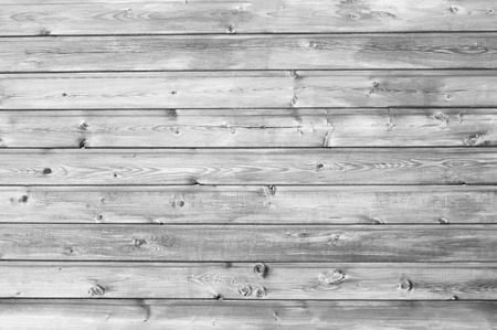 nailed: Wooden planks nailed to the wall studs