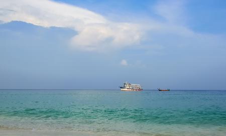 motor boat: Motor boat in the sea at the pier in Pattaya. Stock Photo