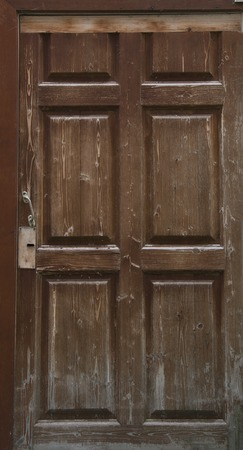 rural areas: Old brown wooden door in rural areas. Close-up. Stock Photo