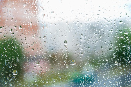 windowpane: In the evening, the rain on the windowpane. Use as a background. Little depth of field