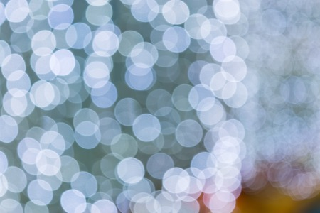 blurring: Blurring background for a holiday greeting card, banner advertising. Shimmering bokeh, lights of the city. Stock Photo