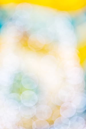 Blurring background for a holiday greeting card, banner advertising. Shimmering bokeh, lights of the city. Stock Photo
