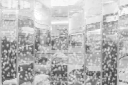 Blurring background for a holiday greeting card, banner advertising. Black and white glass storefront.