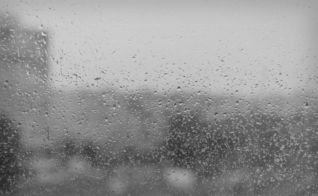 windowpane: In the evening, the rain on the windowpane. Use as a background. Low depth of focus. Stock Photo