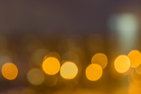 efectos especiales: Blurring background for a holiday greeting card, banner advertising. Shimmering bokeh, lights of the city. Foto de archivo