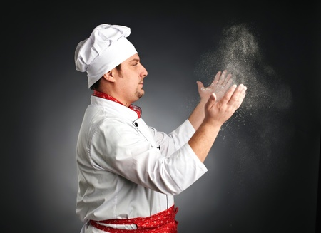 cook with hands in flour on grey background Stock Photo