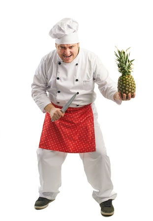 emotional cook with knife and pineapple Stock Photo