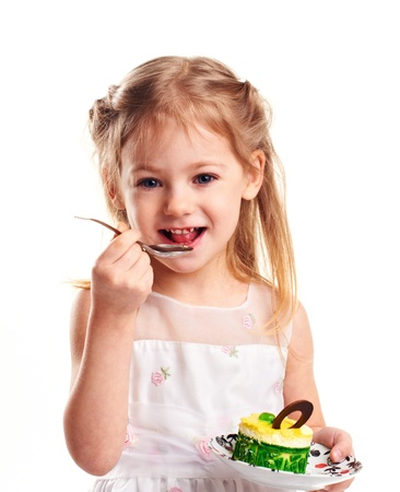 portrait of a little girl with cake and spoon