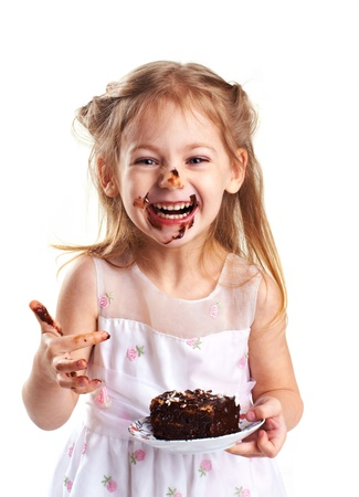 emotional portrait of a little girl with cake Stock Photo