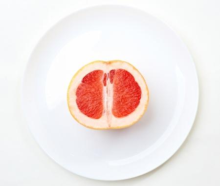cut grapefruit on a plate