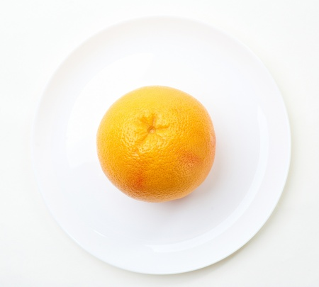 whole grapefruit on a plate Stock Photo