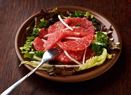 salad with grapefruit on a table
