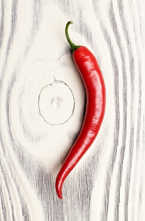 red chili peppers on a wooden surface