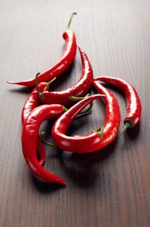 hot chili peppers on a wooden table whith selective focus Stock Photo