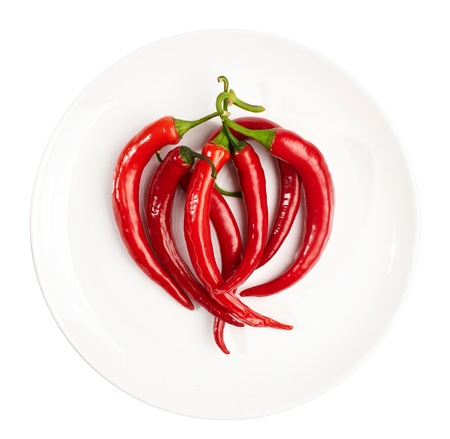 a lot of pepper on white plate