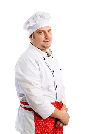 smiling chef in uniform with red apron Stock Photo