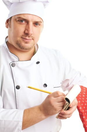 attractive cook writes  order in notebook