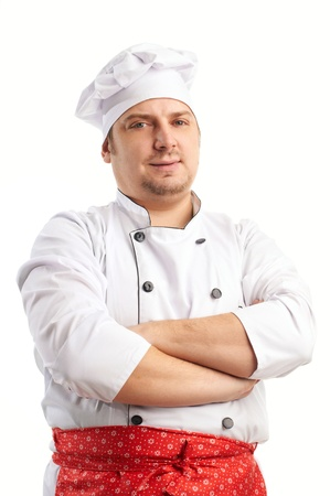 smiling cook in uniform with red apron Stock Photo
