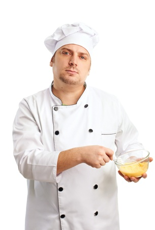 chef in white whisking eggs and oil