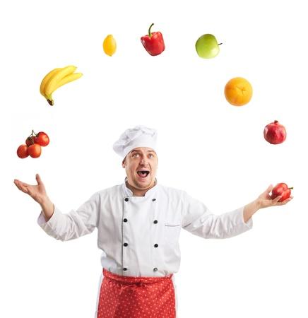emotional cook juggles fruit and vegetables photo