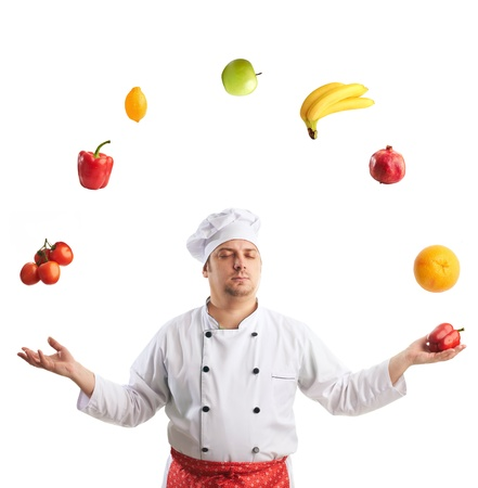 chef  juggles fruit and vegetables with eyes closed