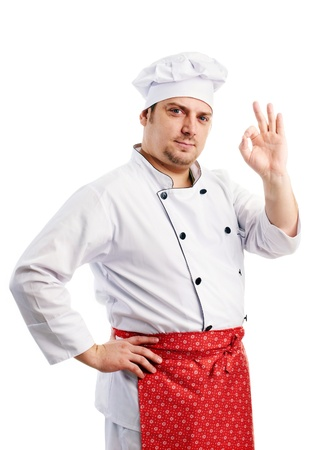 smiling chef in uniform shows the fingers photo
