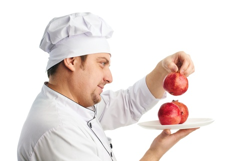 chef in uniform with pomegranates