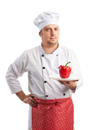 attractive chef in uniform with pepper
