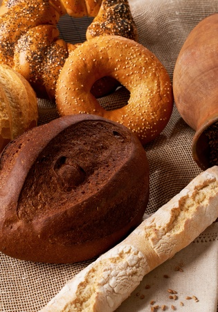 assortment of baked bread on tablecloth