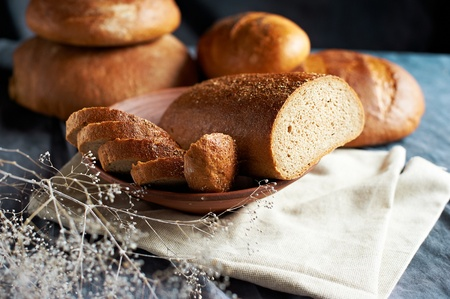cut bread on plate, still life