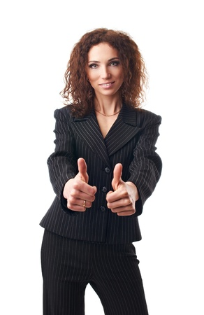 Beautiful  businesswoman shows thumbs up on white background