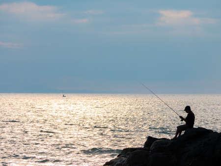Silhouette of fisherman, Lombok, Indonesia