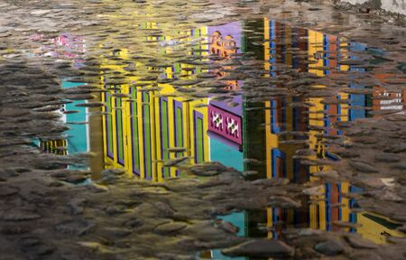 Cobblestone with reflection of colorful City of Guatape, Colombia Stock Photo
