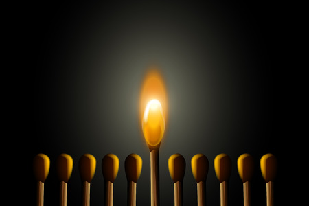 small group: illustration of small group of matches in the darkness