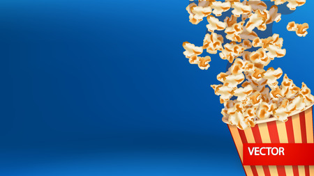 movie and popcorn: illustration of blast of popcorn in the bucket on blue background