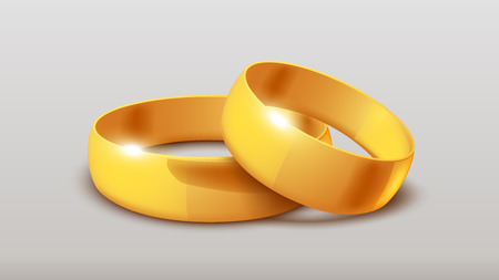 wedlock: illustration of two gold wedding rings lying on grey background