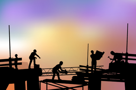 builders silhouette at sunset