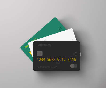 three credit cards lying on grey background