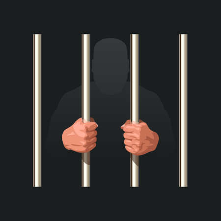 hands of prisoner holding metal jail bars