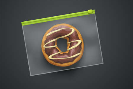 transparent plastic package with donut on dark