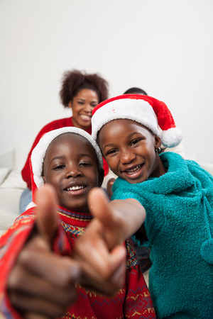 Brothers fingers up in christmas Stock Photo