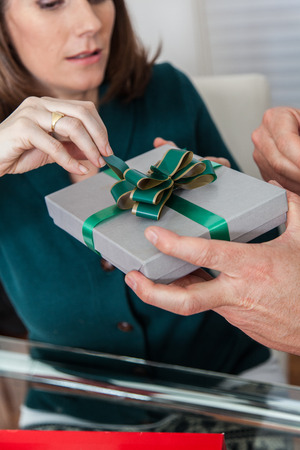 35 to 40 years old: Woman opening the gift