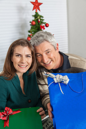 35 40 years old: Man and woman with gifts Stock Photo