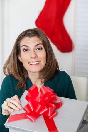 35 to 40 years old: Woman opening her surprise Stock Photo