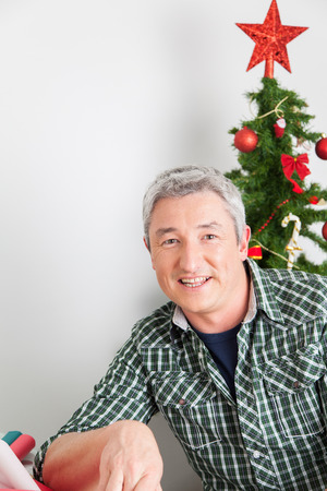35 to 40 years old: Happy man in christmas Stock Photo