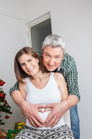 35 40 years old: Happy pregnant wife and husband Stock Photo