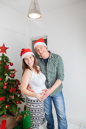 35 40 years old: Pregnant with husband on christmas Stock Photo